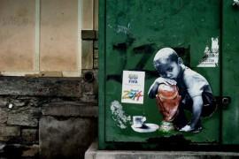 صور : برازيليين ضد إقامة كأس العالم ينشرون رسوماتهم في الشوارع