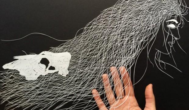 صور : فنان يقصص الورق ليحوله إلى لوحات فنية !